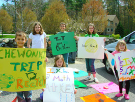 Students from Mere Lane neighborhood make signs for the May Day parade